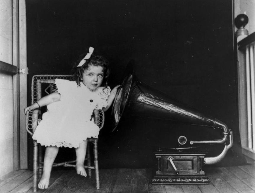 statelibqld_2_179487_doris_auguste_heindorff_listening_to_a_gramophone_new_farm_brisbane_1903-1913